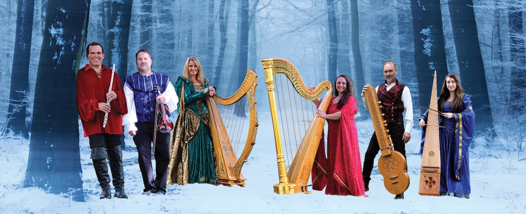 Lori Pappajohn with Winter Harp Ensemble holding harps and other instruments.